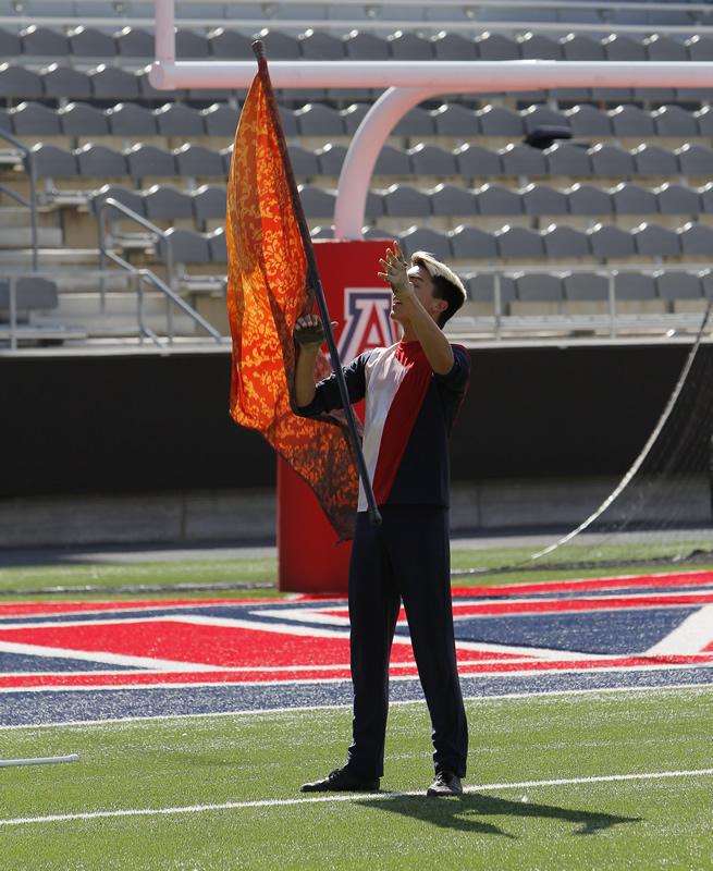 UA Guard member tossing a flag
